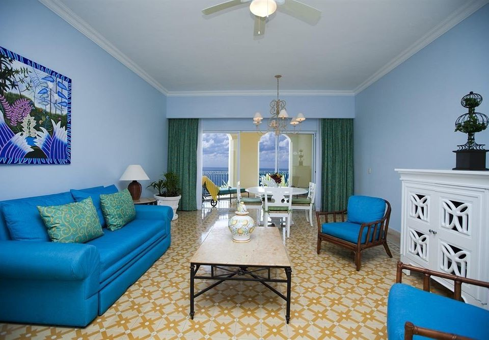 sofa blue living room property home Bedroom cottage Villa condominium painted colored leather