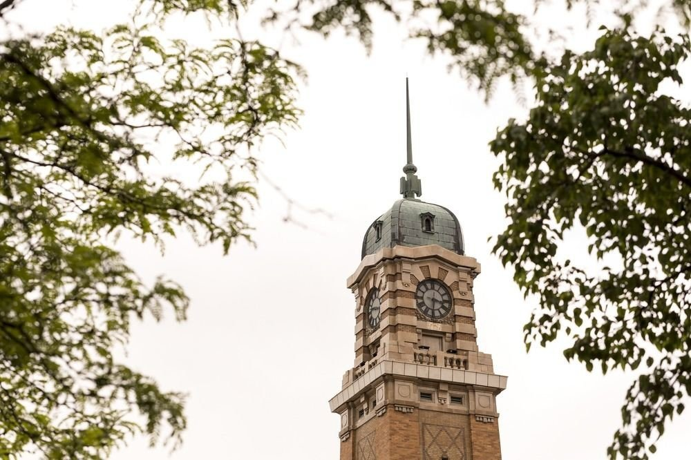 tree sky tower building steeple place of worship bell tower spire chapel tall day