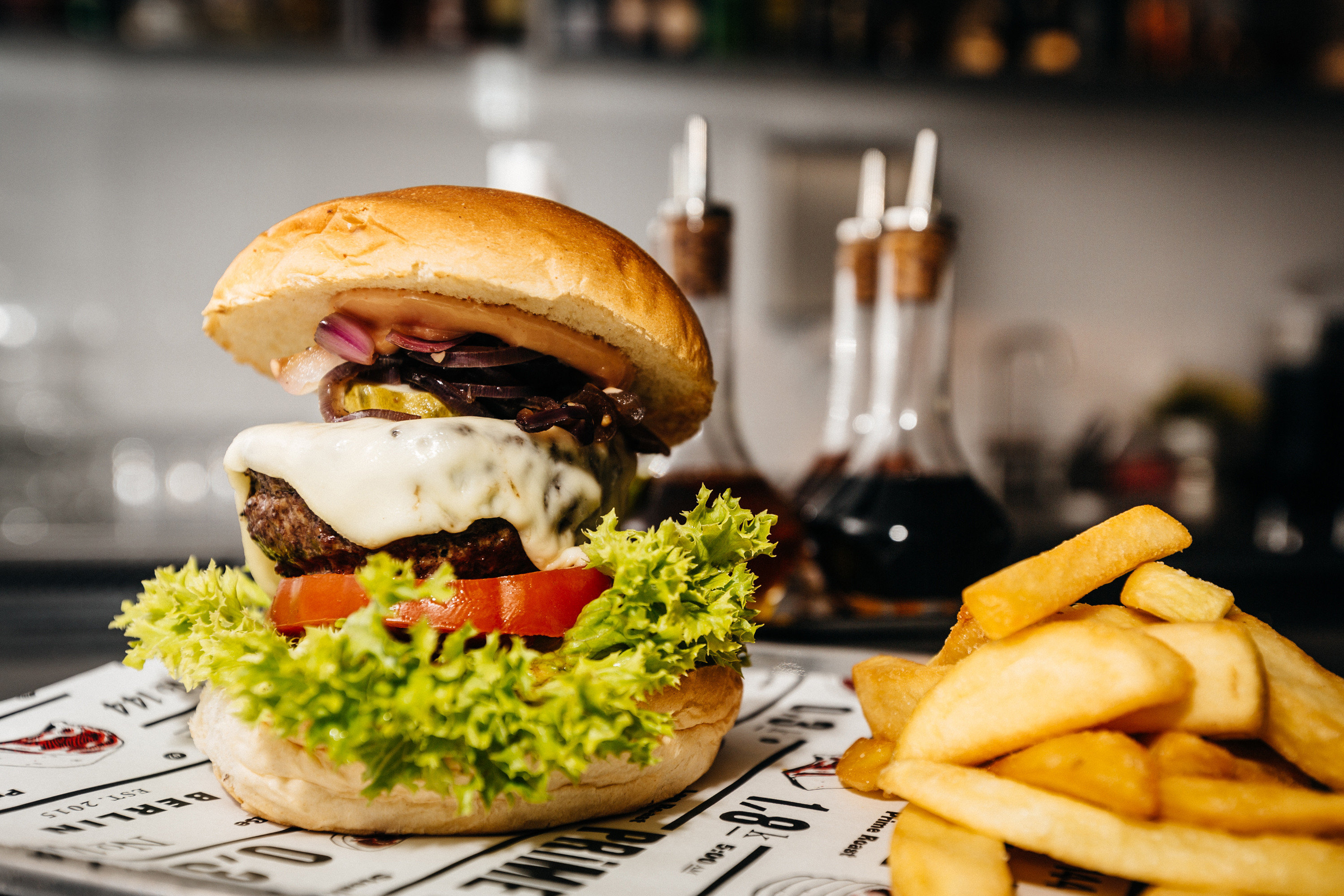 Berlin Boutique Hotels Germany Hotels Luxury Travel food hamburger plate fries fast food snack food sandwich restaurant sense lunch cheeseburger brunch fast food restaurant tray french fries meat cuisine junk food potato