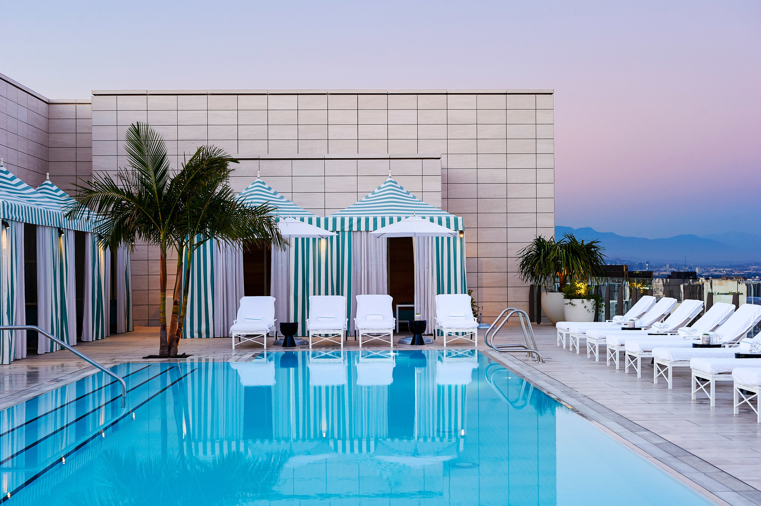 Boutique Hotels Hotels Luxury Travel sky chair swimming pool water property Architecture leisure Resort hotel real estate condominium Pool vacation estate leisure centre apartment resort town building Villa corporate headquarters facade area furniture Deck