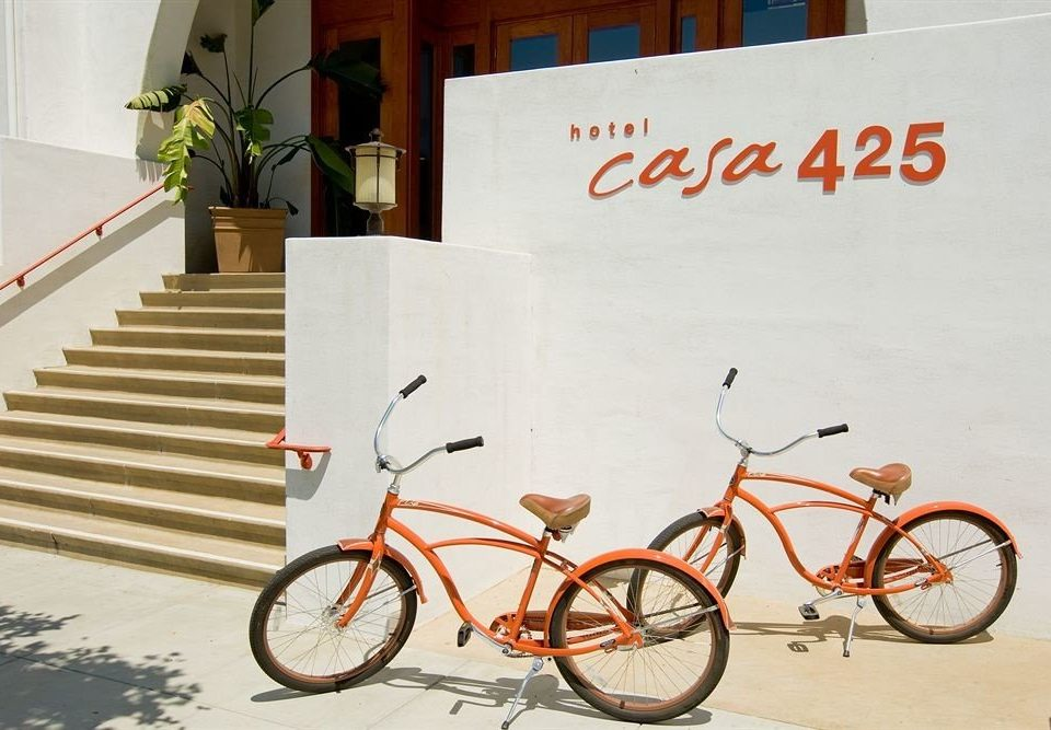 bicycle vehicle land vehicle orange sports equipment