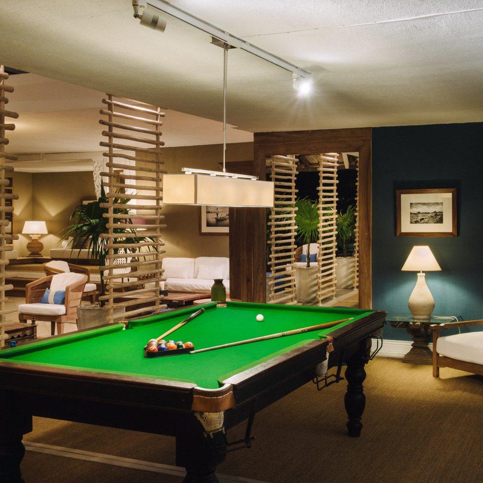 pool table poolroom billiard room recreation room pool ball scene green cue sports billiard table games indoor games and sports gambling house