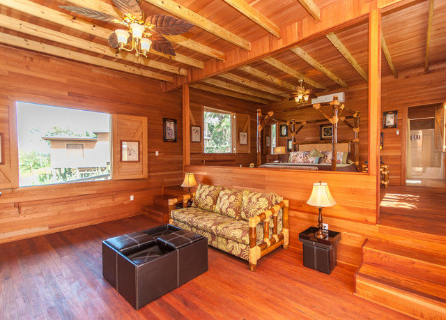 property recreation room log cabin home hardwood wooden billiard room living room wood flooring cottage farmhouse mansion