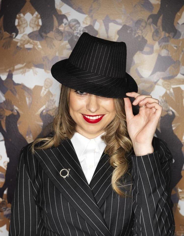 black clothing hat cap fedora headdress hairstyle fashion accessory fashion headgear facial hair pattern