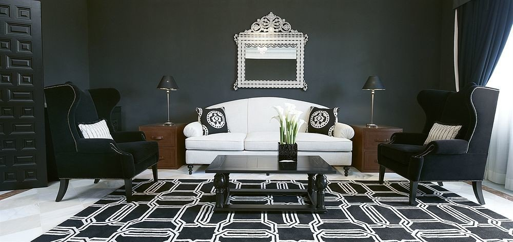 sofa black chair living room property home leather flooring rug