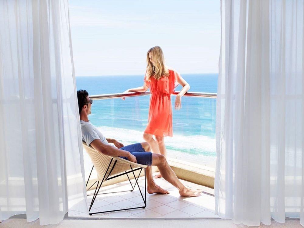 human positions sitting leisure clothing product blond leg photo shoot shore