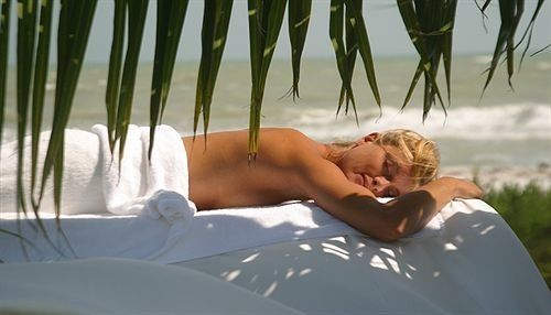 hair blond muscle sun tanning leg laying interaction