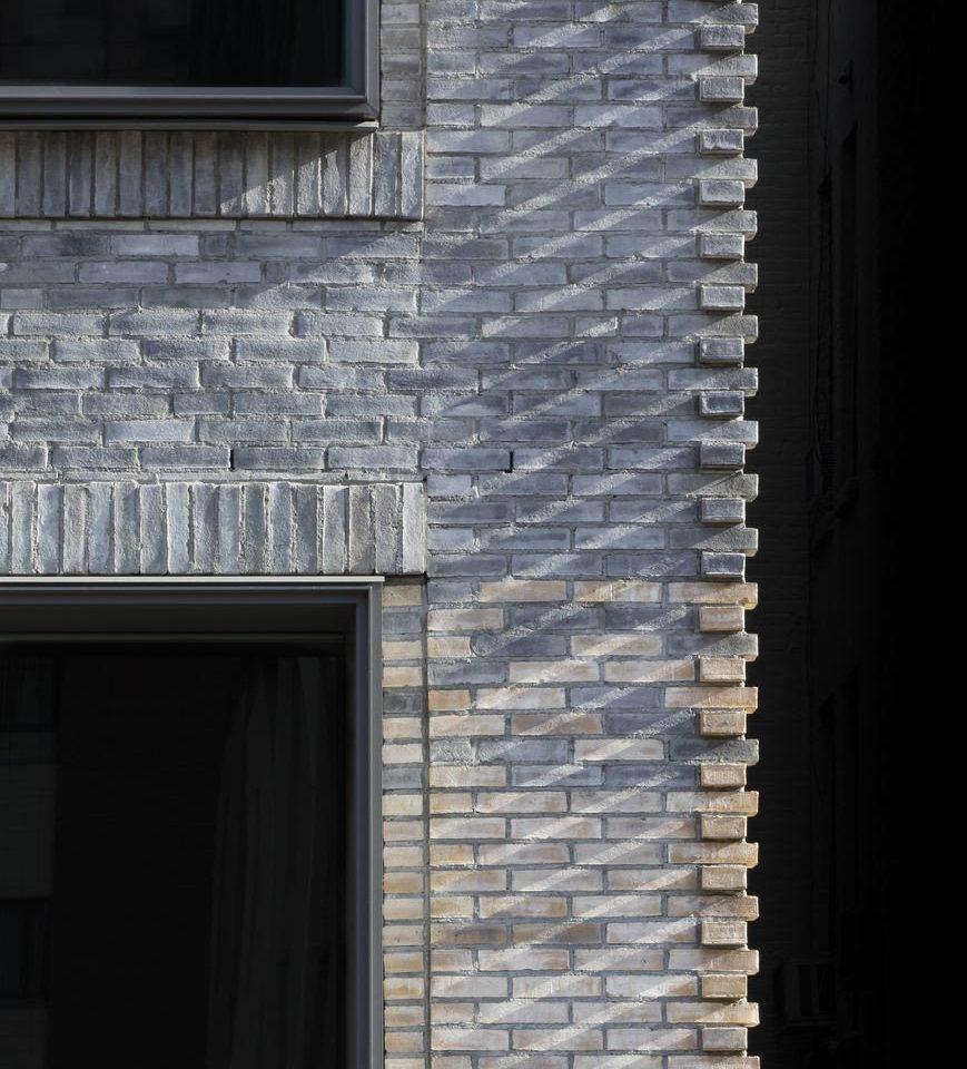 building white blue brick stone house brickwork siding material door column
