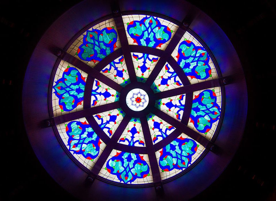 building color stained glass blue glass dark light wheel circle lighting material lit symmetry bright colorful