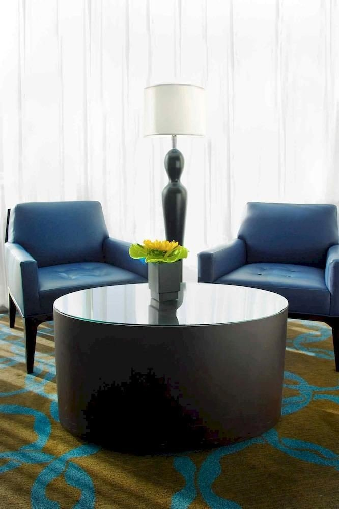 living room blue chair couch seat coffee table sofa