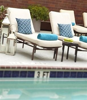 leisure chair swimming pool blue living room flooring outdoor furniture dining table