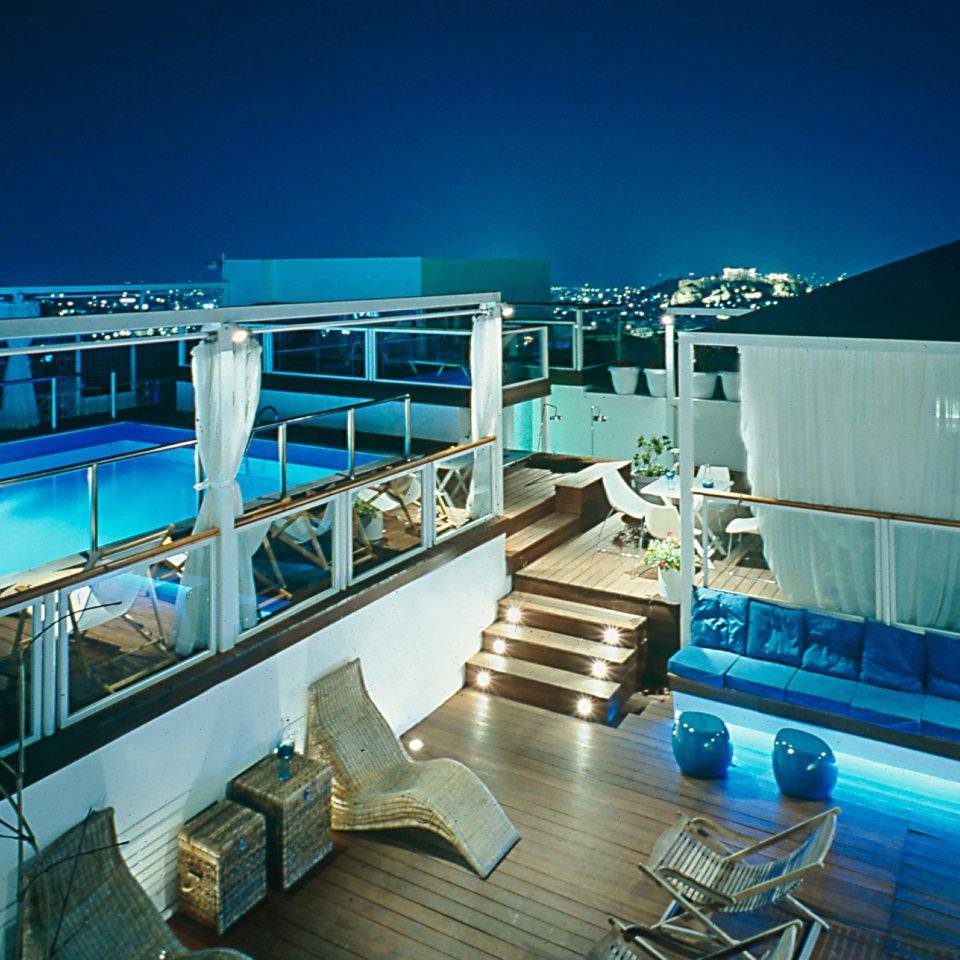 vehicle passenger ship marina dock cruise ship swimming pool condominium blue
