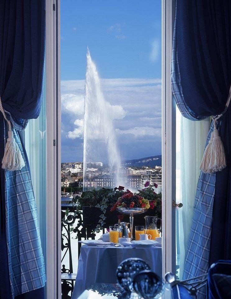 blue curtain window treatment opened