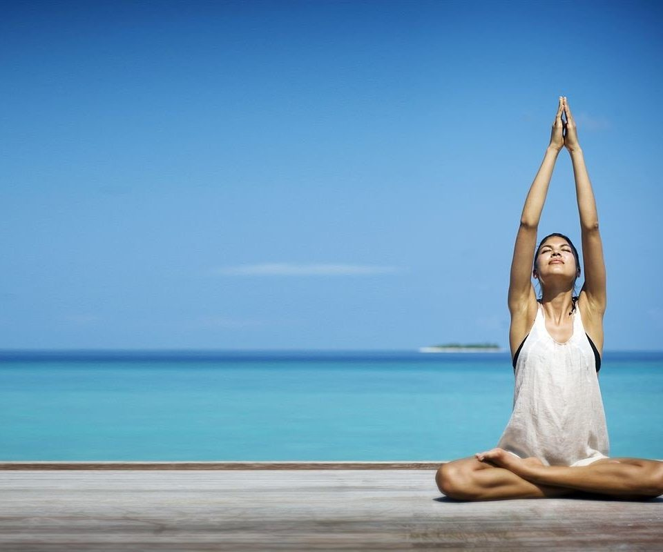 sky water blue human positions sitting sports physical fitness yoga shore