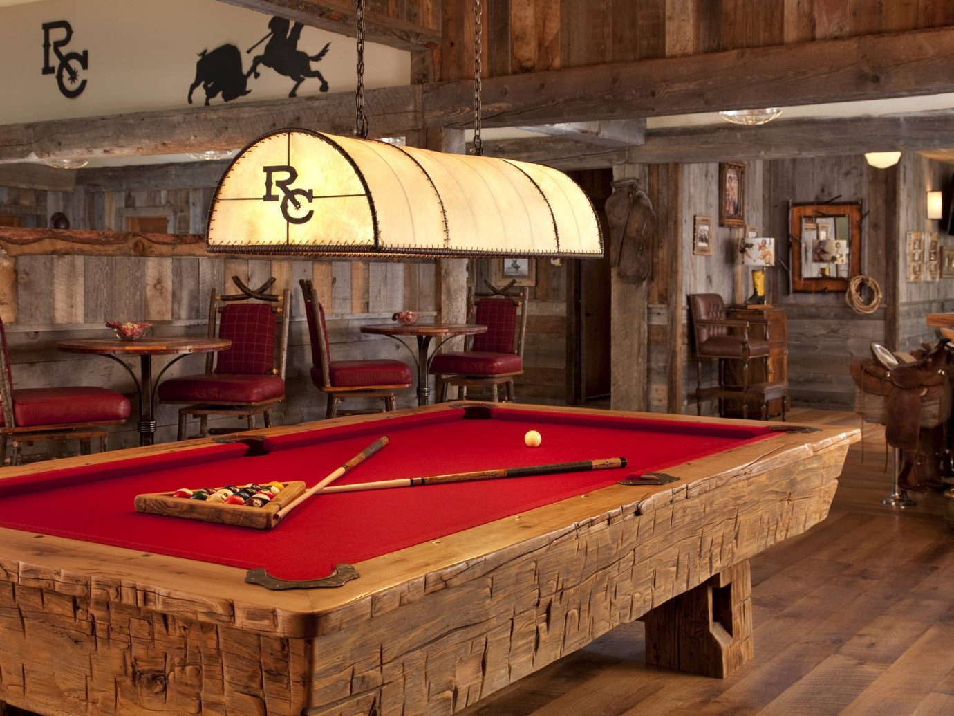 Glamping Hotels Montana Outdoors + Adventure Trip Ideas indoor billiard room recreation room floor room wooden billiard table furniture games wood estate table indoor games and sports cue sports