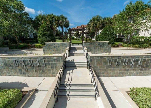 tree sky walkway property park waterway plaza boardwalk cement stone