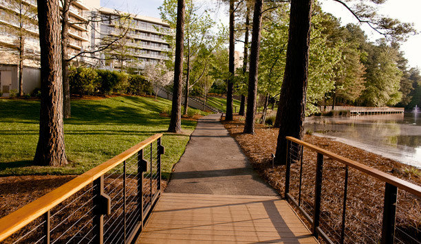 tree grass walkway plant path park water recreation outdoor structure boardwalk landscape cottage trail leisure