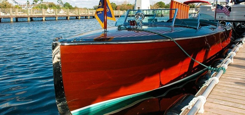 Boat water vehicle sailboat watercraft rowing docked watercraft dock motorboat skiff dinghy fishing vessel mast boating tied