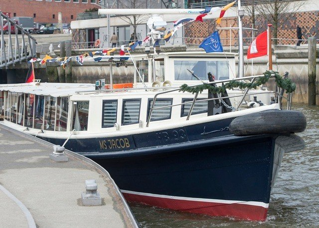 Boat vehicle motor ship watercraft waterway boating dock motorboat fishing vessel ship docked