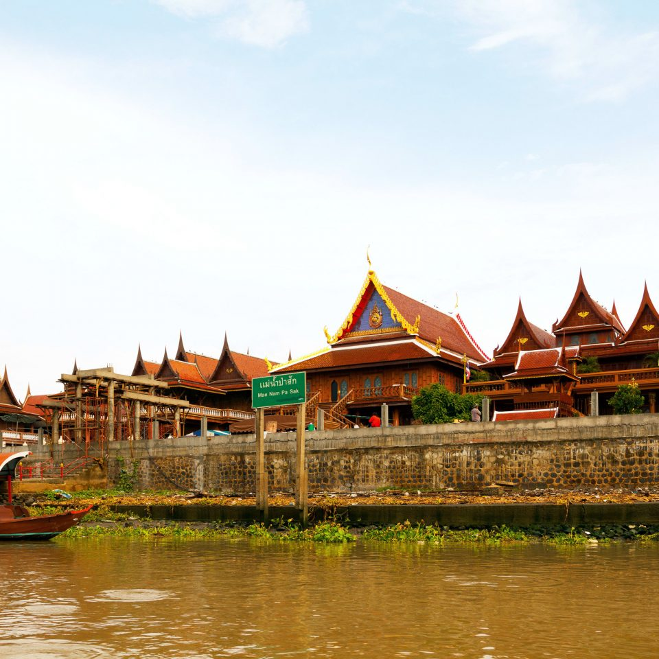 Boat Business City Cultural Elegant Landmarks Luxury River Scenic views Waterfront sky water temple building house wat place of worship pond Nature travel shrine