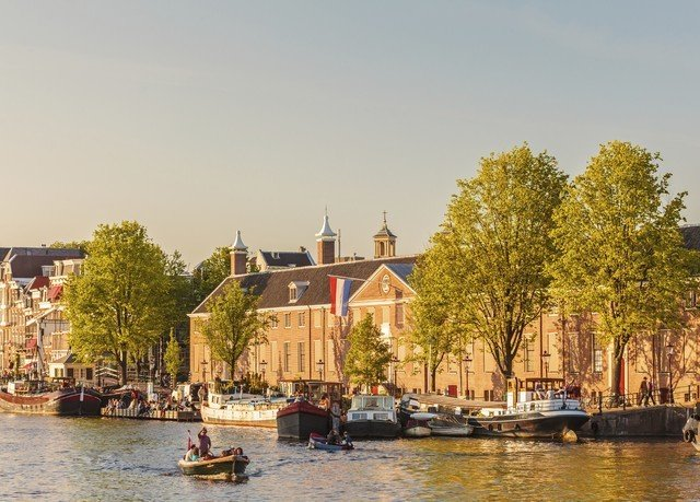 water Boat sky Canal waterway River house Town vehicle boating cityscape traveling surrounded
