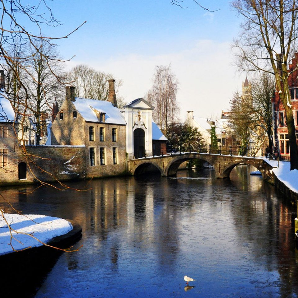 tree Canal water Boat waterway Winter Town River season snow cityscape evening vehicle dock docked