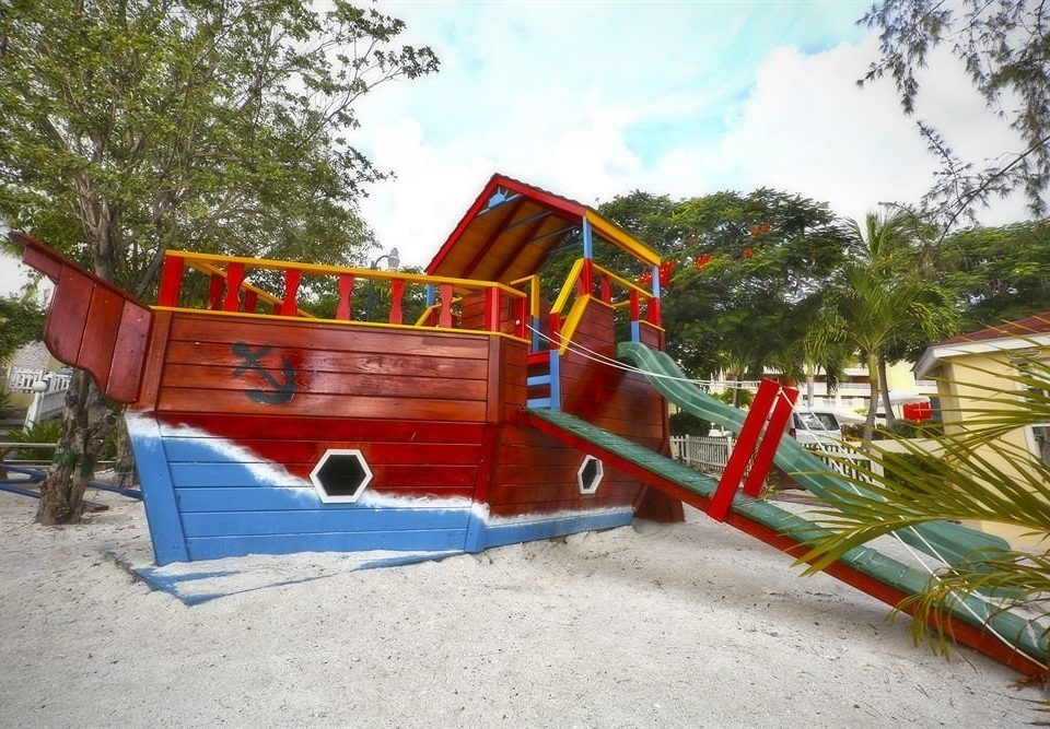 tree Playground City public space outdoor play equipment Play outdoor recreation red recreation playground slide Water park Boat