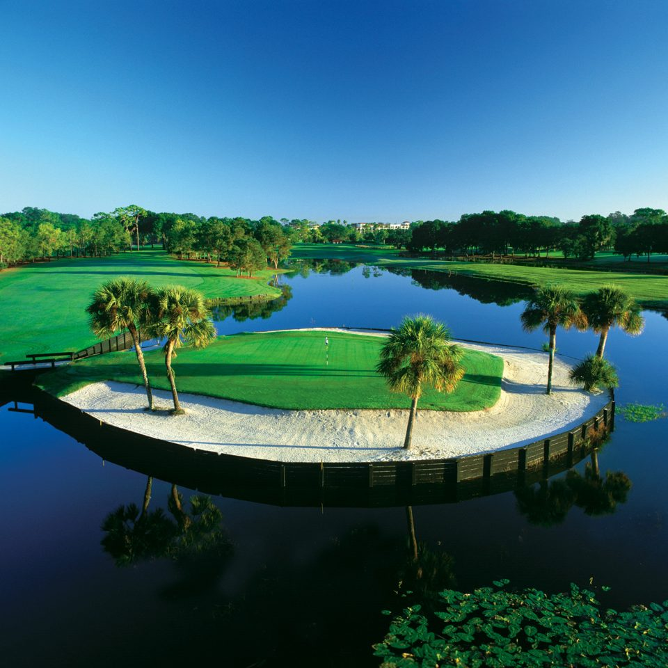 Classic Golf Nature Outdoor Activities Outdoors Resort Sport water sky structure swimming pool leisure green sport venue golf course Lake reservoir pond Lagoon overlooking beautiful Boat distance