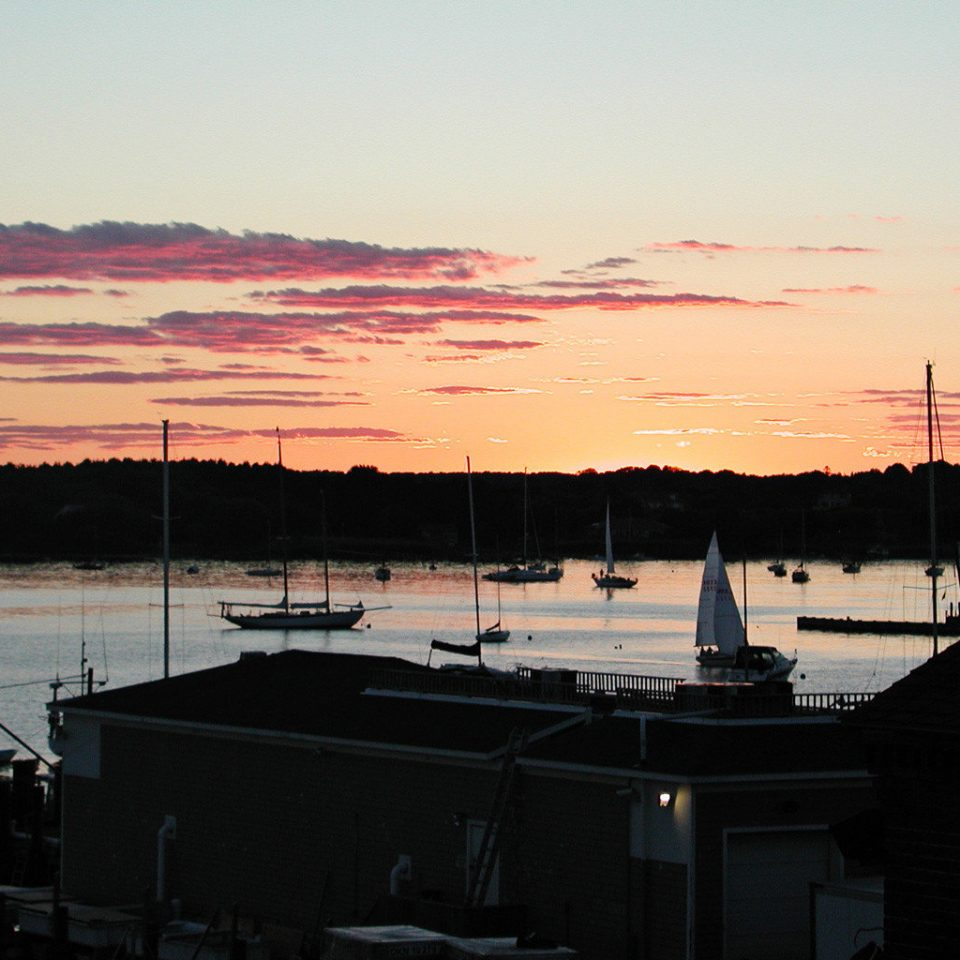 Country Elegant Inn Scenic views sky water Sunset Boat Sea sunrise dawn afterglow dusk dock horizon vehicle evening morning scene marina Ocean Harbor Coast skyline