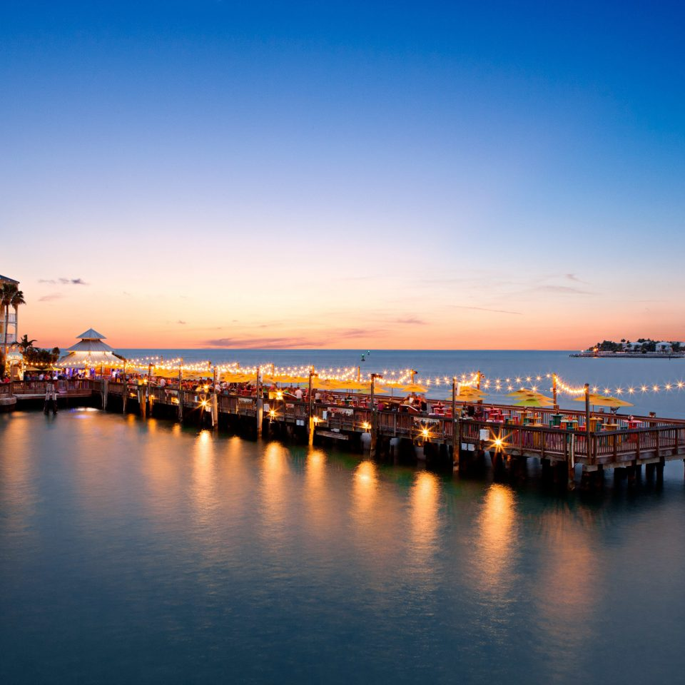 Elegant Exterior Resort Waterfront water sky Boat scene River horizon Sea dusk Sunset evening night dawn cityscape morning Ocean sunrise Coast long pier skyline docked Harbor traveling
