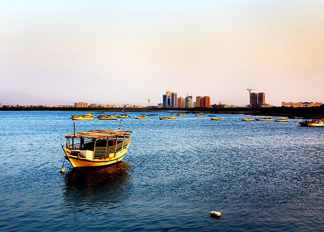 water sky Boat scene yellow Sea horizon vehicle Harbor shore floating Ocean Lake morning evening dusk watercraft Coast Sunset skyline cityscape day