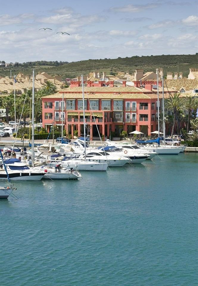 water Boat sky marina scene Harbor vehicle dock Sea docked house channel port Coast Lake waterway boating Town surrounded