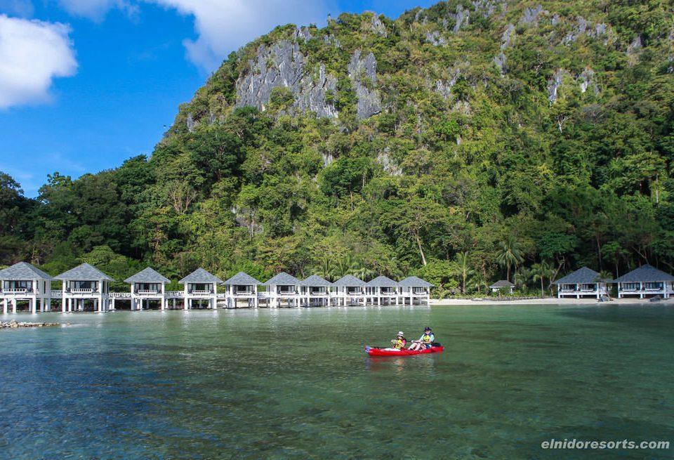 tree water Boat Sea Coast vehicle Lake boating cove Lagoon Island surrounded