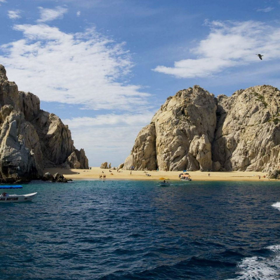 sky water mountain rock Boat Sea vehicle boating Coast Nature cape cliff kayak terrain cove kayaking day Island