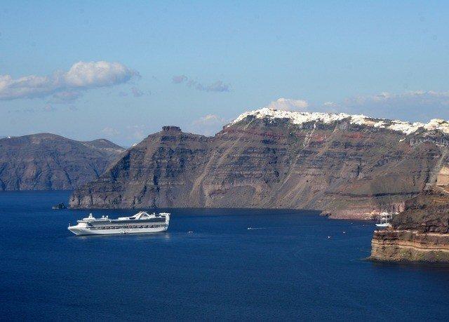 mountain water sky Nature Sea Coast Boat cliff fjord vehicle background Ocean terrain cape passenger ship day Island