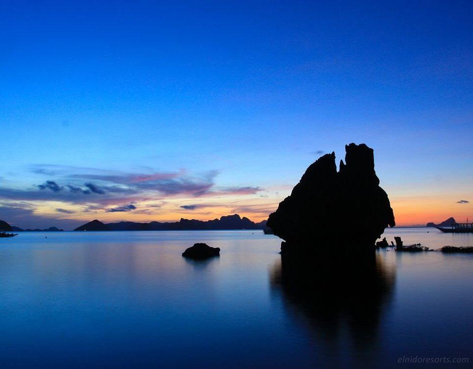 water sky Boat horizon Sea sunrise dawn cloud Coast Sunset dusk Ocean afterglow shore morning loch evening Lake distance