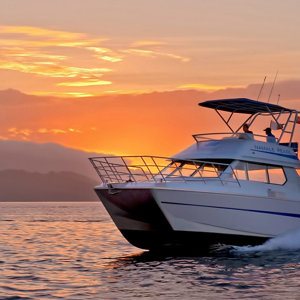 Scenic views Waterfront sky water Boat vehicle Sea Sunset horizon Ocean boating Coast watercraft shore