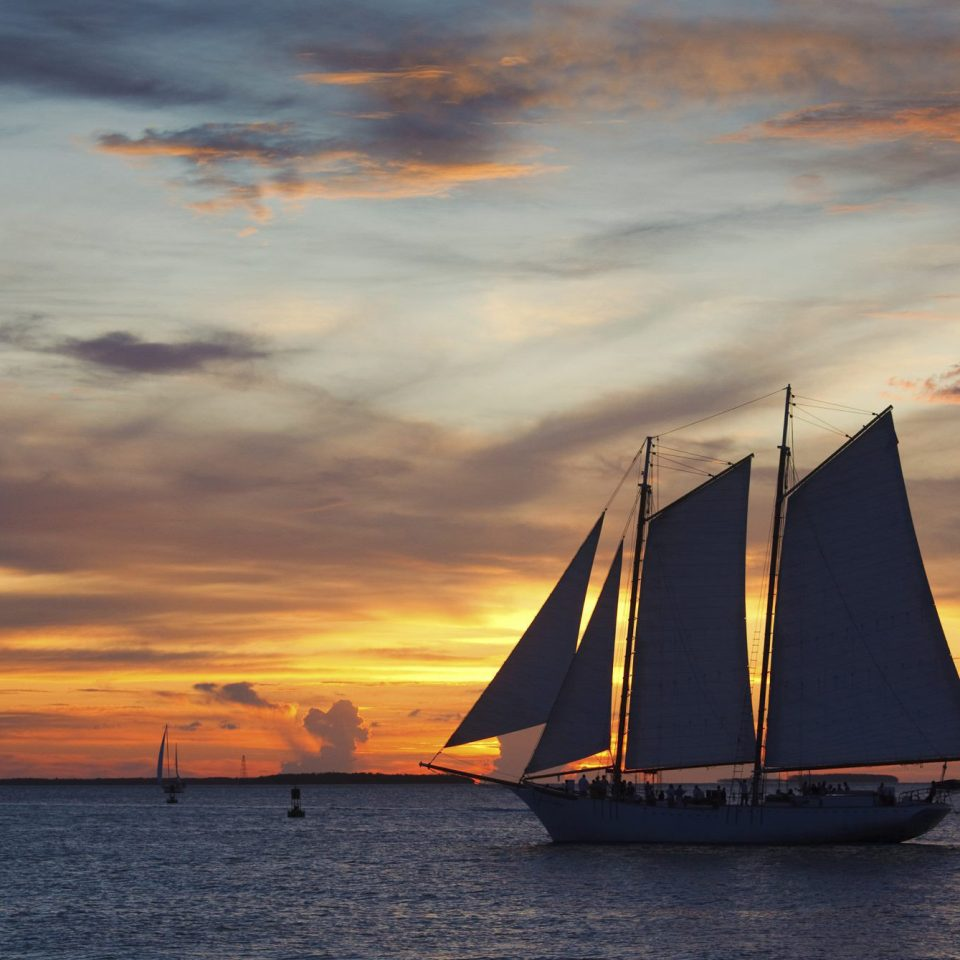 water sky transport Sunset watercraft sailing vessel Boat Sea cloud sailing ship horizon sailboat vehicle sunrise Ocean sail evening morning dawn dusk Coast cloudy sailing ship sunlight clouds distance