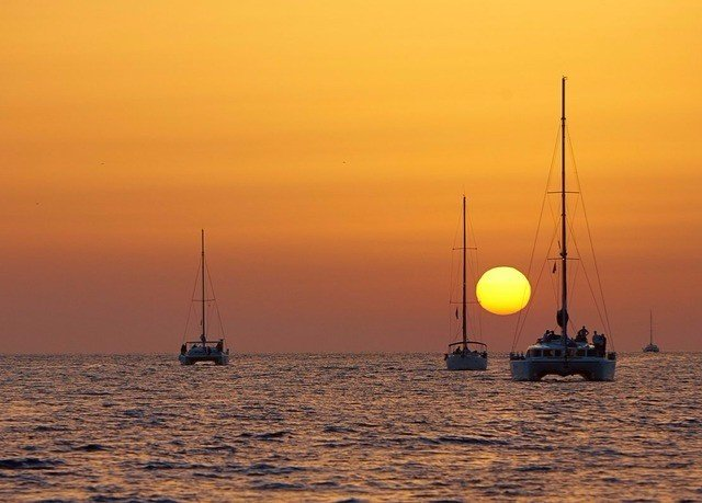water sky Boat Sea Sunset sunrise horizon Ocean vehicle dawn sailing morning evening dusk ship sail floating Coast sailboat Sun mast shore sailing vessel distance day