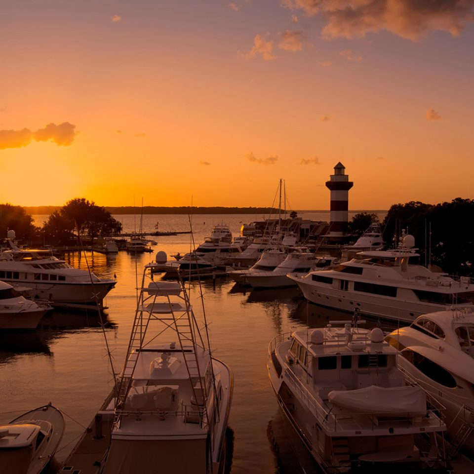 sky water Sunset Boat sunrise dawn Sea afterglow dusk horizon Sun evening morning scene Coast setting clouds day