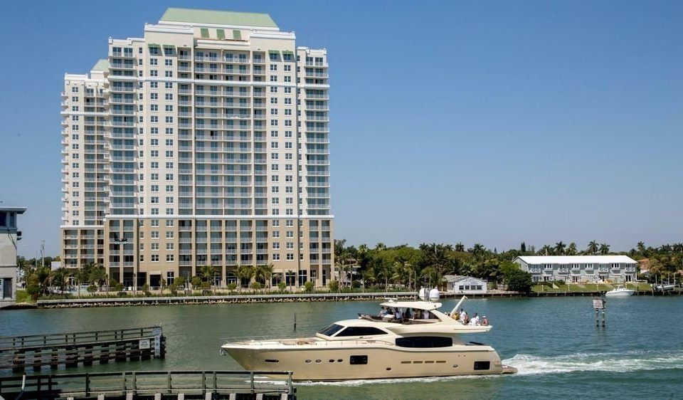 water sky Boat marina dock vehicle passenger ship tower block condominium