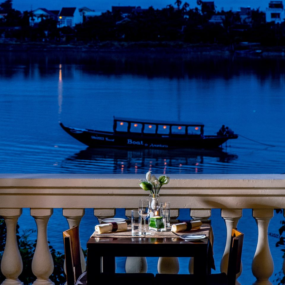 Boat Cultural Dining Drink Eat Jungle River Sunset Terrace Tropical Waterfront water blue