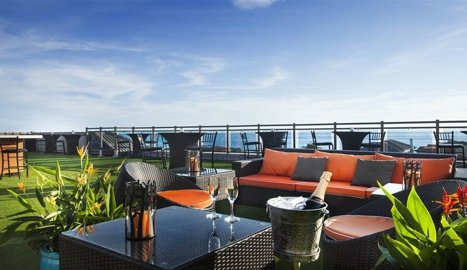 Drink Eat Lounge Rooftop sky chair property vehicle Boat passenger ship Resort marina orange set