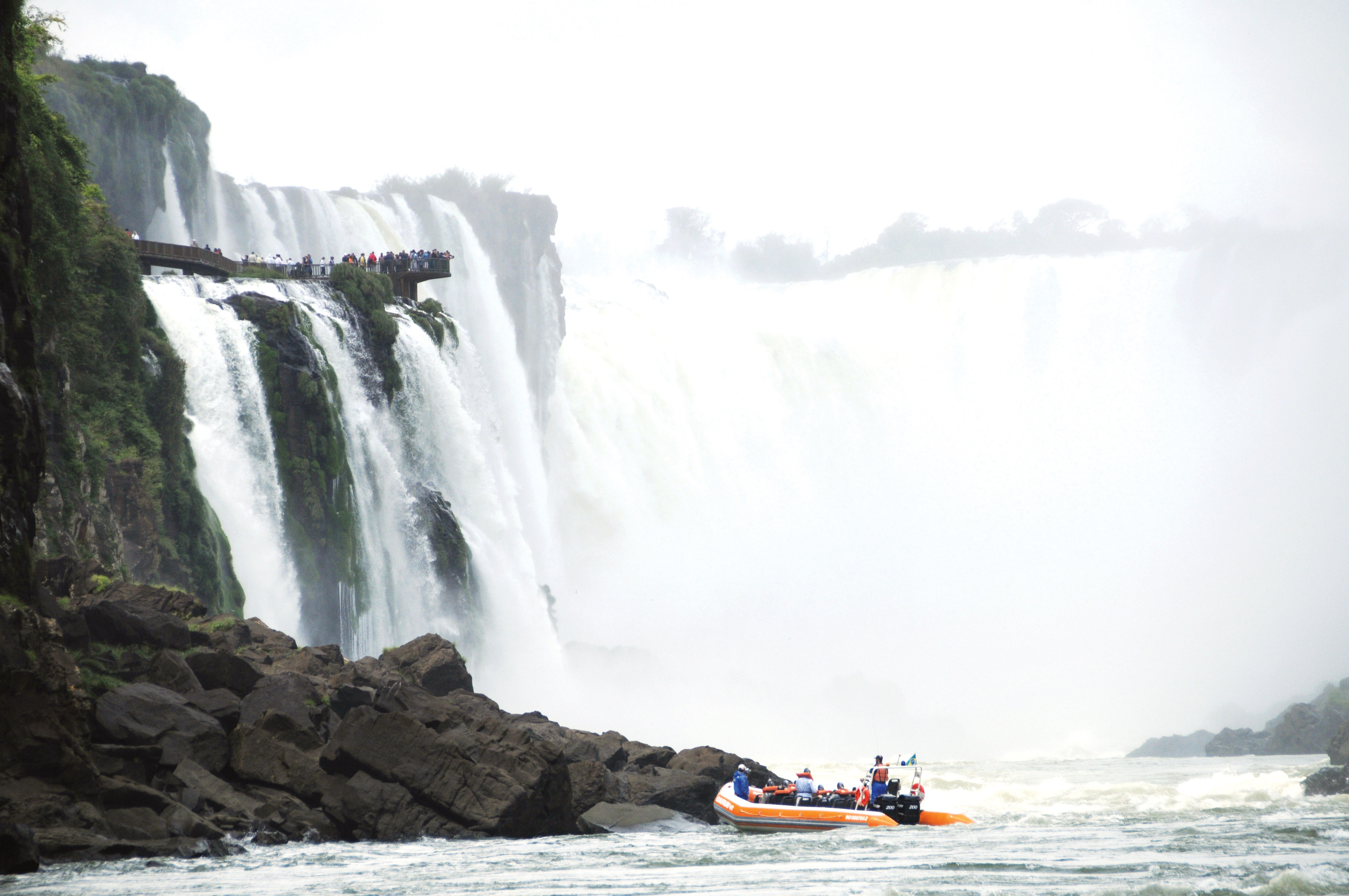 Boat Entertainment Natural wonders Nature Outdoor Activities Outdoors Scenic views Trip Ideas Waterfall water sky mountain rock boating kayaking rapid vehicle extreme sport wind wave water feature Sea kayak