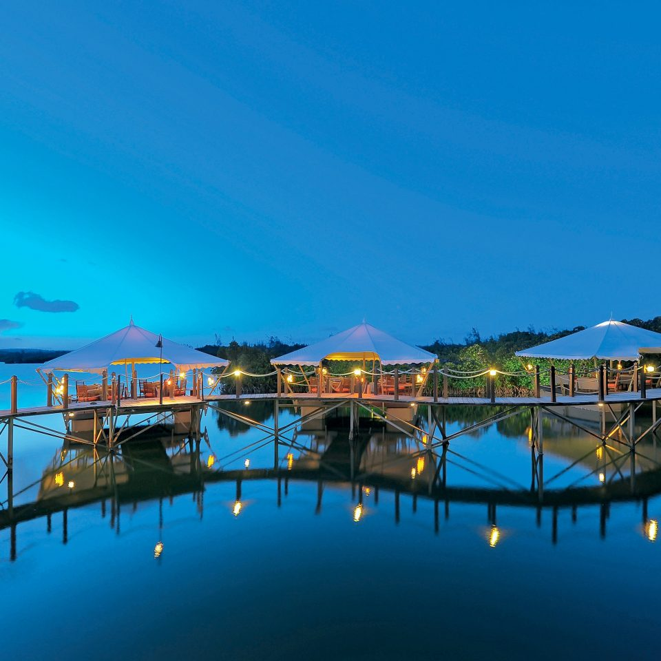 Family Honeymoon Overwater Bungalow Resort Romance Romantic Tropical Waterfront sky water Boat scene swimming pool marina Harbor Sea dusk Lake