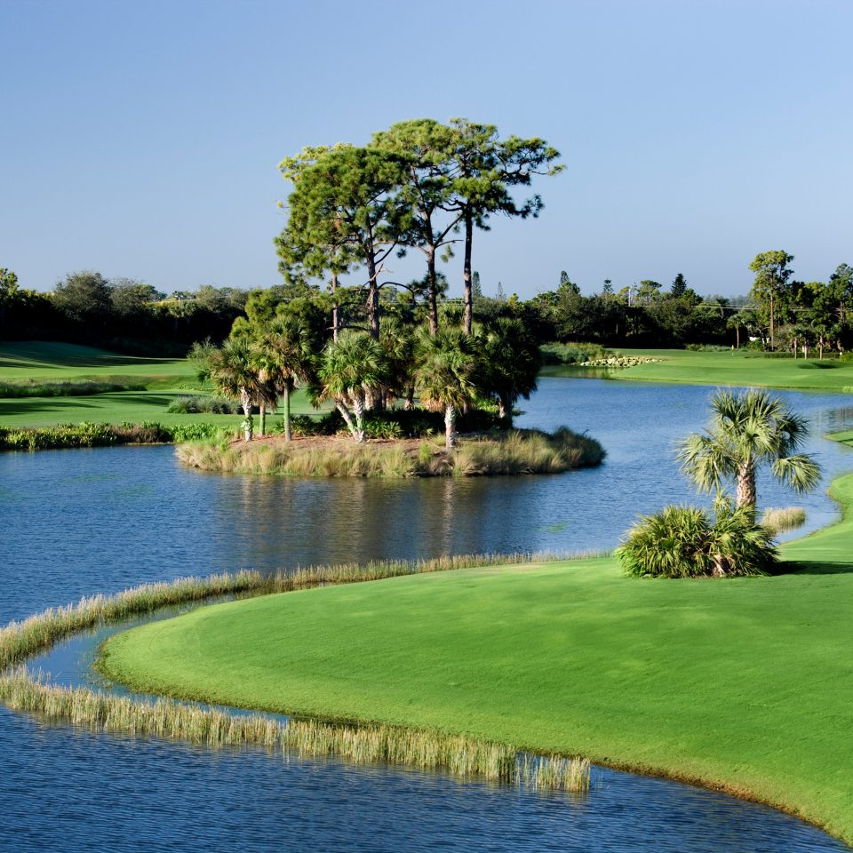 Golf Nature Outdoors water sky grass tree River Lake structure Boat ball game sports sport venue golf course golf club outdoor recreation recreation Resort pond shore lawn individual sports surrounded tied Island