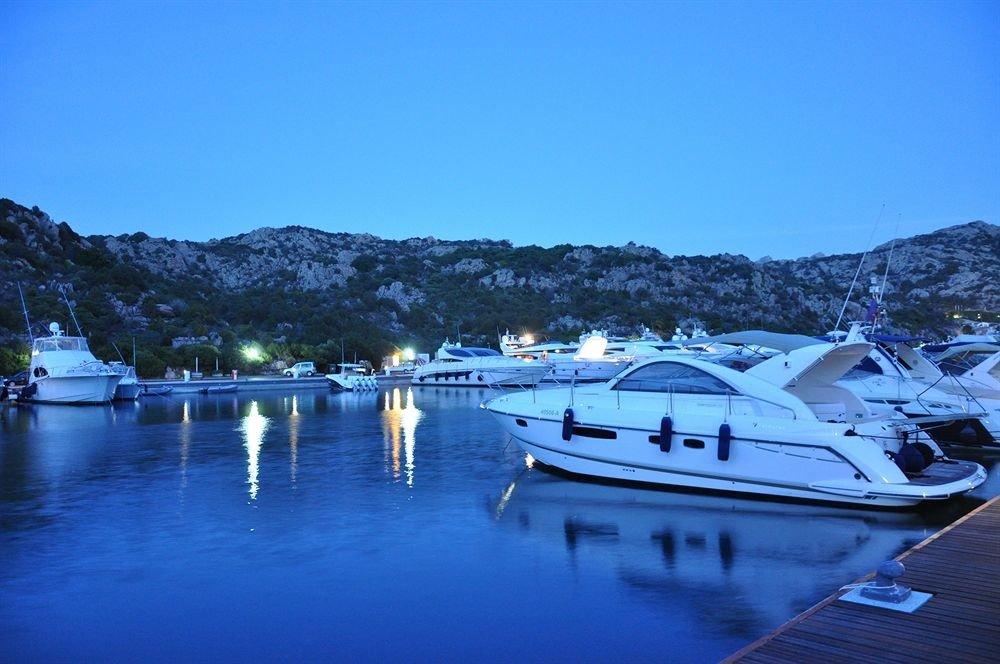 water sky Boat marina dock Sea vehicle Lake Resort Lagoon Harbor docked