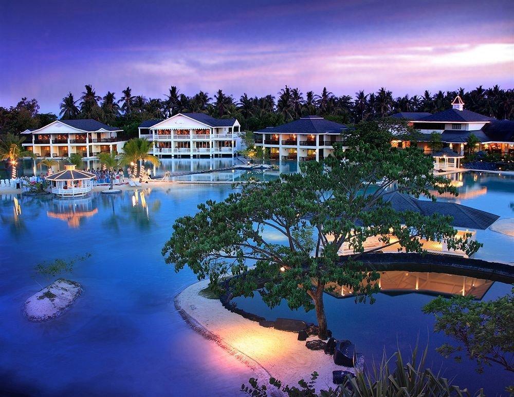 sky water tree swimming pool Resort Boat marina Harbor resort town dock Lagoon dusk surrounded day