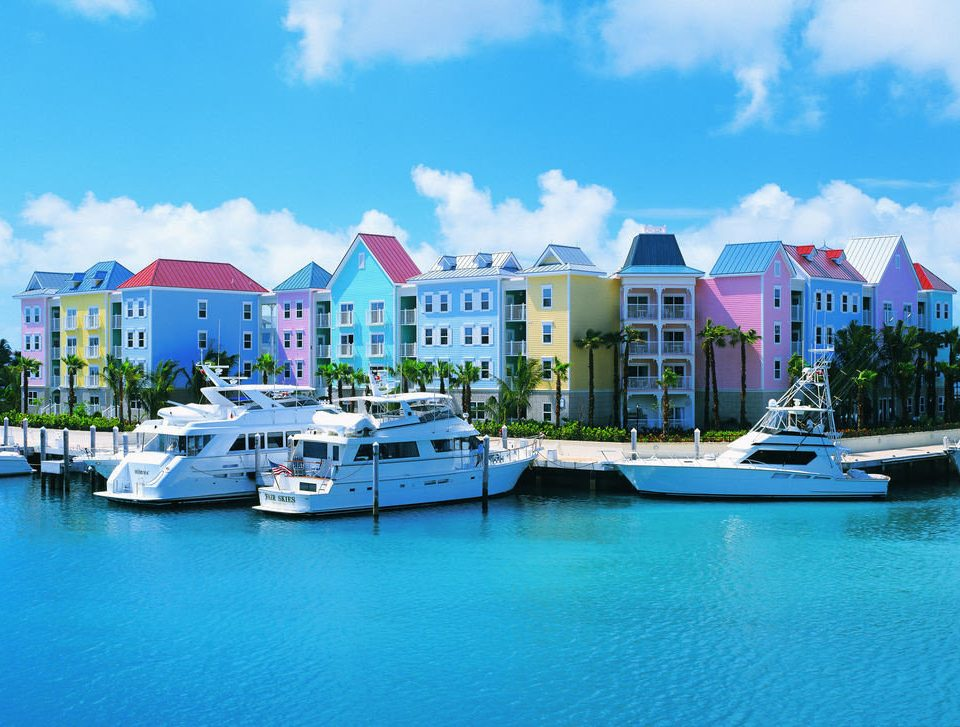 water Boat sky docked scene dock marina Harbor floating Lake Town house Sea vehicle Resort port caribbean shore blue surrounded