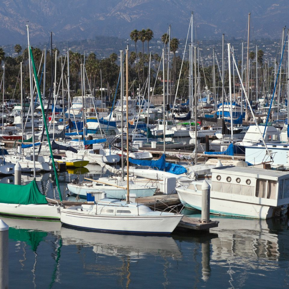 Boat Ocean water sky marina scene Harbor dock vehicle Sea port infrastructure sailboat mast bunch crowded day